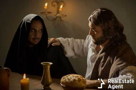 Jesus touches a mysteryous looking Judas in the shoulder during the Last Supper