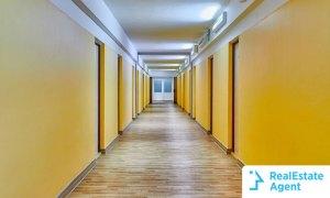 An empty student dorm hallway