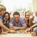 family playing boardgame together