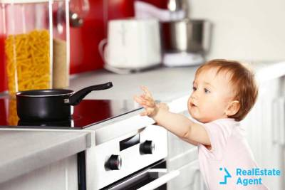 child near electric stove