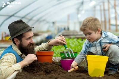 dad and son gardening together