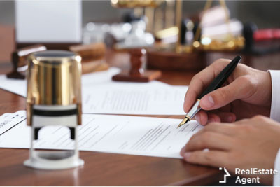 man preparing to sign official document