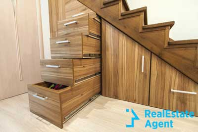 amazing wooden storage space under the stairs