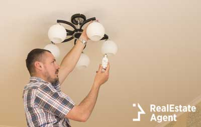 replacing the lightning bulb in the bathroom chandelier