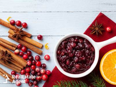 Cranberry sauce in ceramic saucepan  decorated with fir tree for Thanksgiving day