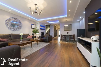 beautiful living room with led design on the ceiling