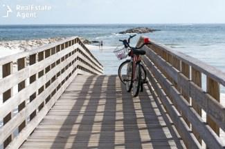 bikes on boardwalk leading to the beach