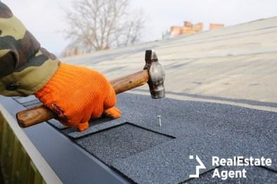 work hand installing bitumen