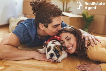 young happy couple with their puppy