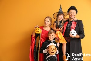 family with kids in halloween costumes