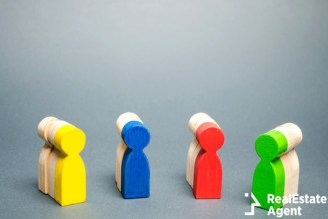 group of multicolored wooden people