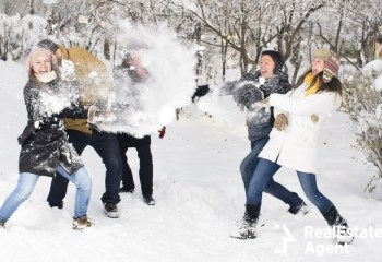 young people playing in the snow