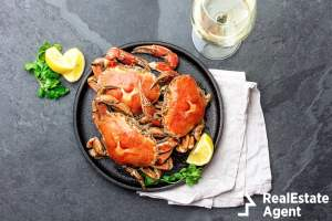 cooked crabs in black plate