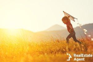 happy child girl kite running on