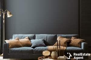 modern interior with dark blue sofa