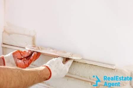 worker installing gypsum