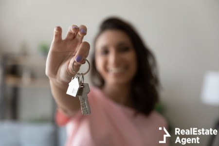 Woman holding key in hand