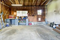 garage-2 Laurie Way Announces | Des Moines Multi-Level Home with Large Yard!