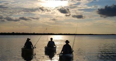 Kayak fishing sunset