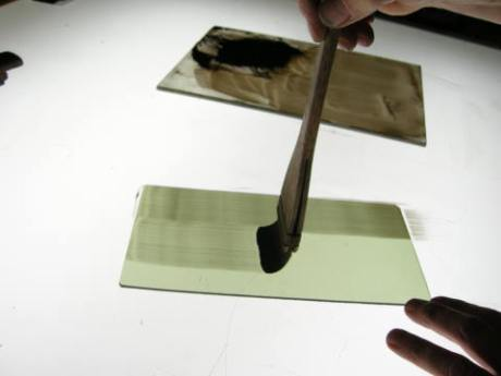 When your paint is the right consistency and your brush is well shaped, you don't need to hold your glass ...