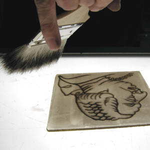 Stained glass painting - how to grip a badger