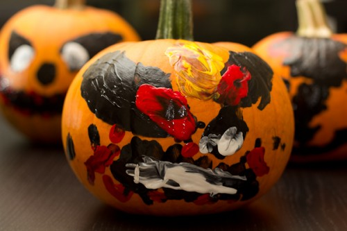 finger painting on a pumpking