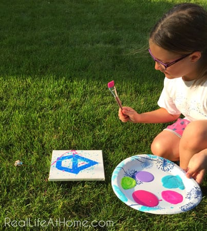 Outdoor splatter painting activity for kids