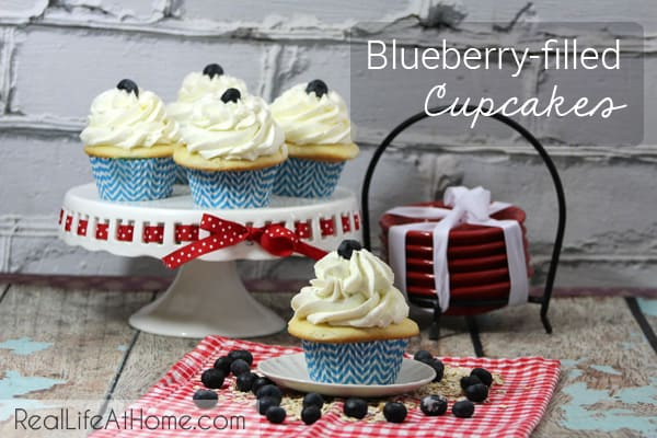 These delicious blueberry-filled cupcakes can be modified to other flavors as well, making them a versatile favorite! | RealLifeAtHome.com