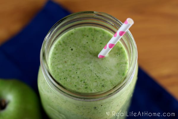 Lots of green flecks in my Granny Smith Tropical Green Smoothie from not peeling the apple before adding it to the blender