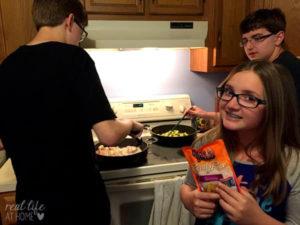 Cooking meals together as a family can save time and be fun!