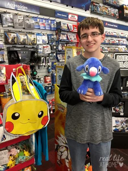 Celebrating the Release of Pokémon Sun and Pokémon Moon at GameStop (with a Popplio Plush)