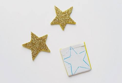 Cutting out stars for 4th of July Banner Craft (from Real Life at Home)