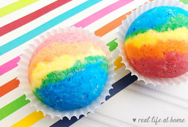 How to Make Homemade Rainbow Bath Bombs - here are two examples with different levels of coloring
