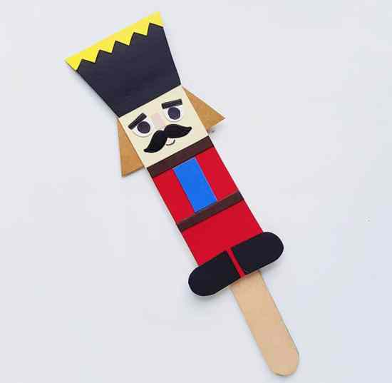 Step five of Nutcracker Stick Puppet Craft for Kids