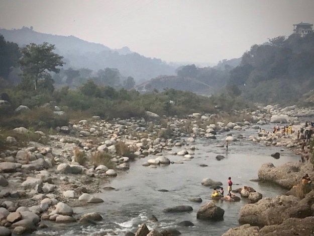 Bathing in the Baner Khad river; Himachal Pradesh