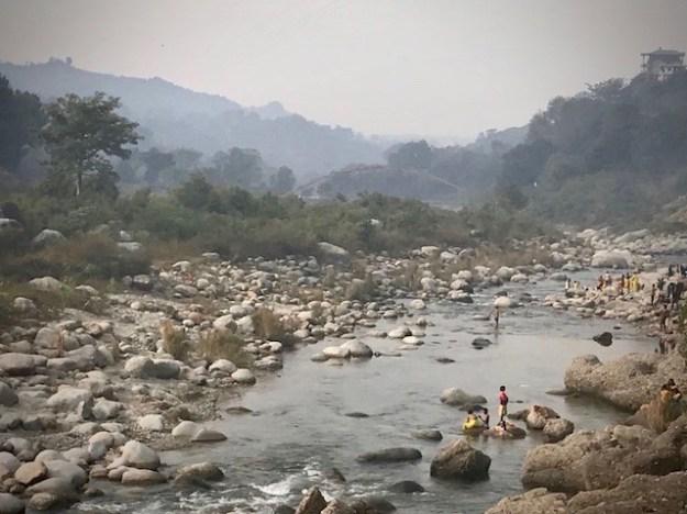 Bathing in the Baner Khad river; Himachal Pradesh