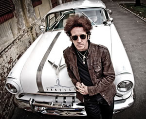 Willie Nile with a car