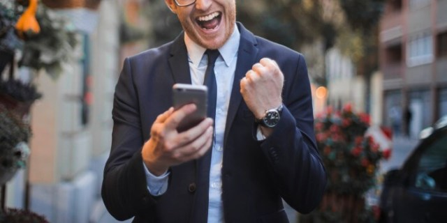 man excited about phone message