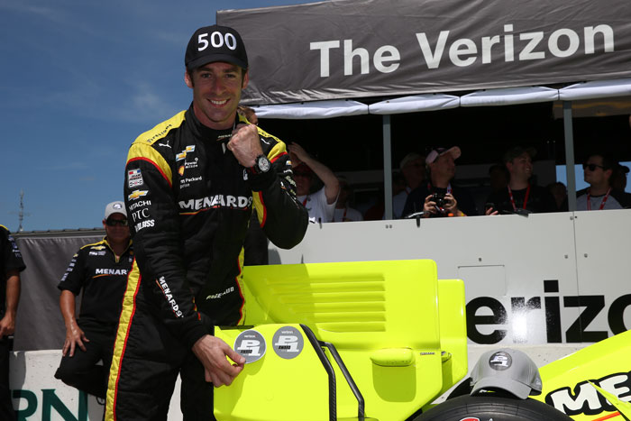 Simon Pagenaud affixes the Verizon P1 Award emblem for winning the pole position for the Iowa Corn 300 at Iowa Speedway
