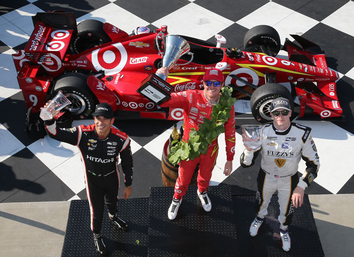 The podium of Scott Dixon, Helio Castroneves, and Josef Newgarden hoist their trophies in Victory Lane following the INDYCAR Grand Prix at The Glen from Watkins Glen International