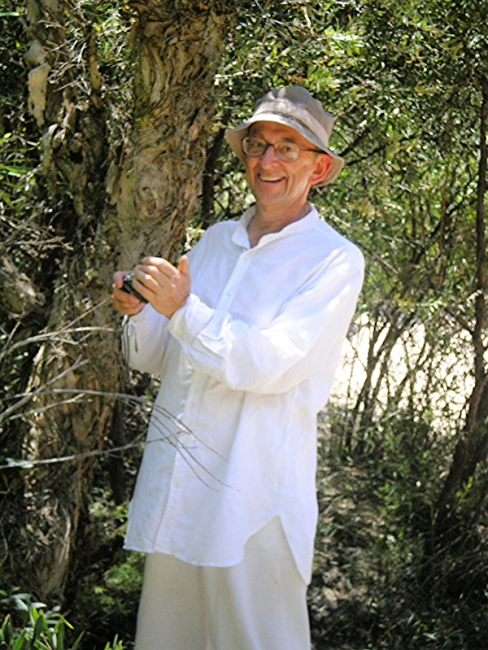 Stuart Hill smiling in the woods