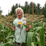 Eric Sideman smiling in a corn field