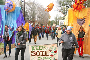 Enid Wonnacott and Kate Duersterberg march to keep the soil in organic