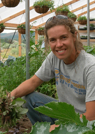 Linley Dixon harvests greens at Adobe House Farm
