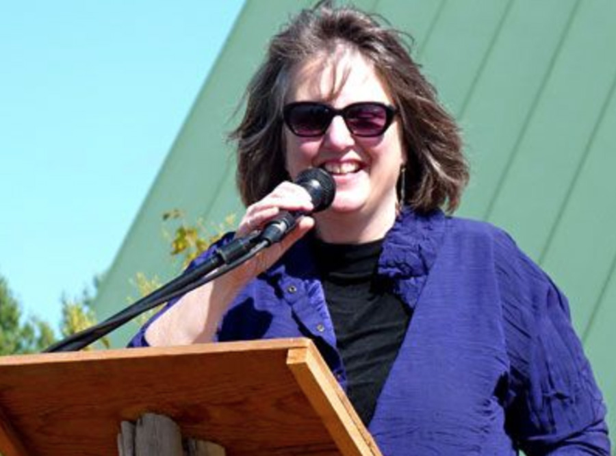 Dr. Kathleen Merrigan speaking at an outdoor event.