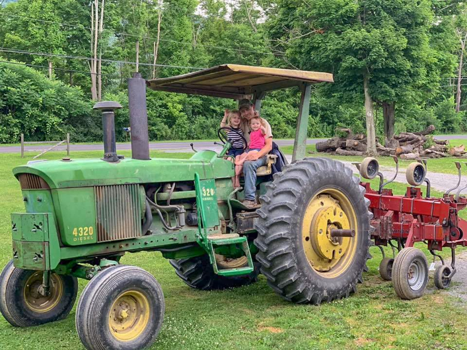 Engelbert family on tractor