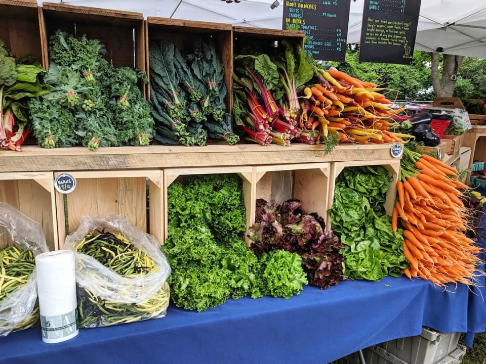 Colorful organic vegetables displayed at the Footprint Farm market booth
