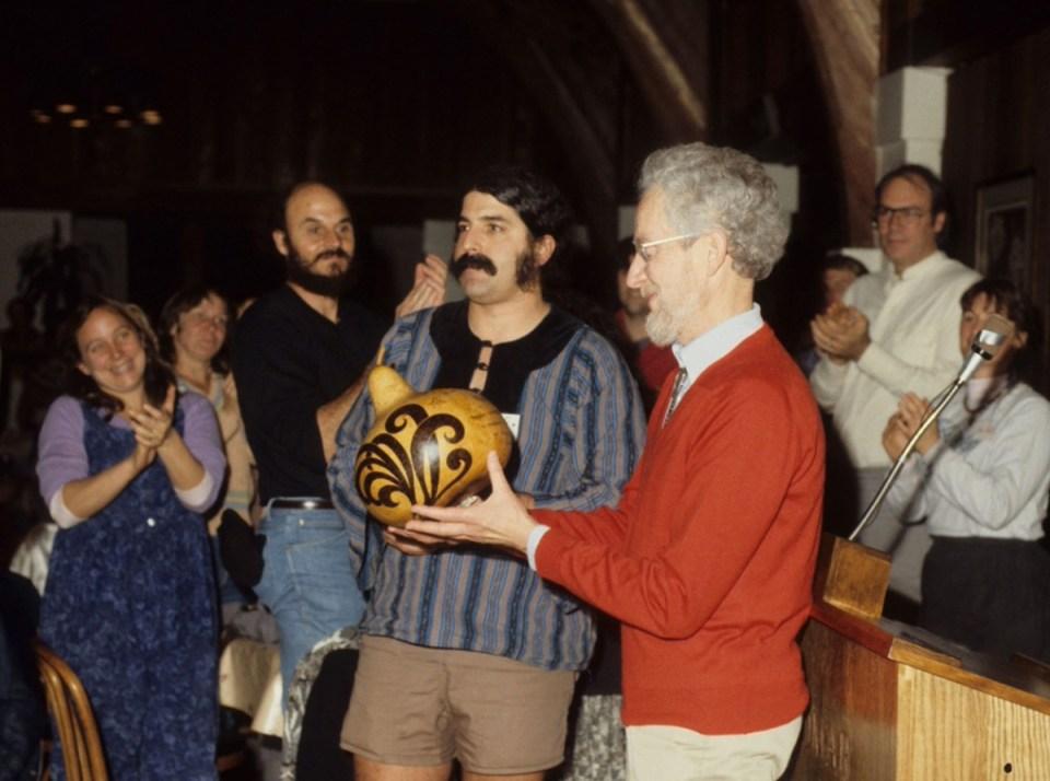 Dru and Amigo Bob giving Robert Rodale the Sustie Award at the 1990 EcoFarm Conference.
