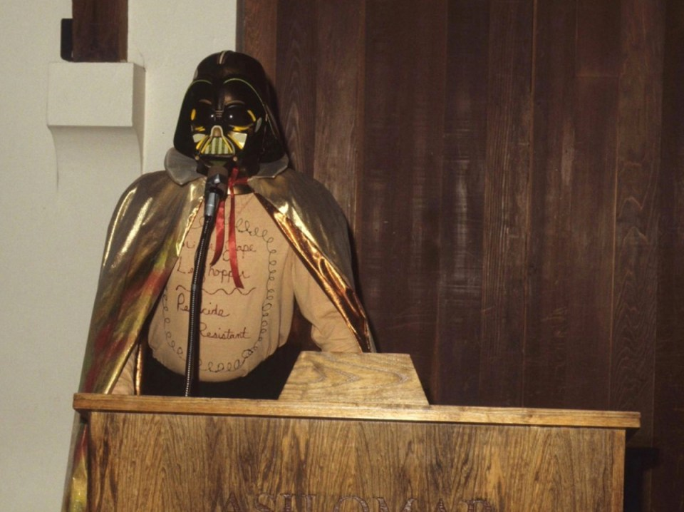 A younger Steve Pavich dressed as darth vader portrays the Dark Side of the chemical industry at an earlier EcoFarm.