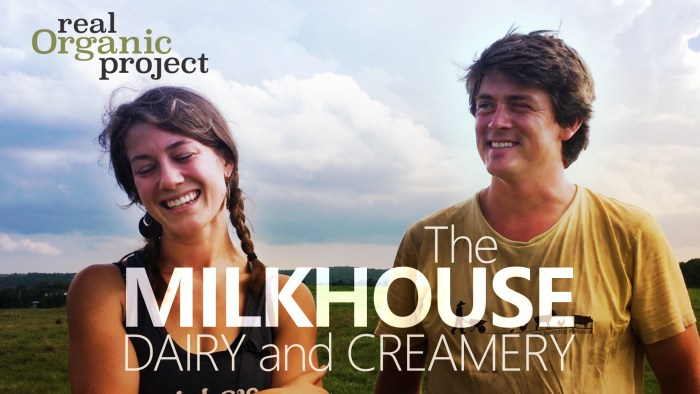 """A young couple smiles with a clouds and pasture behind them. Text overlay reads """"The Milkhouse Dairy and Creamery"""""""